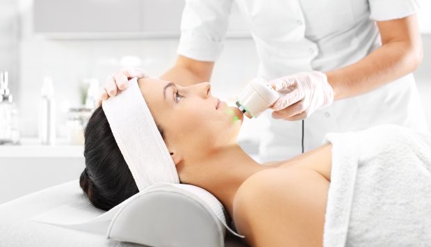 Woman receives laser treatment by a trained dermatology provider