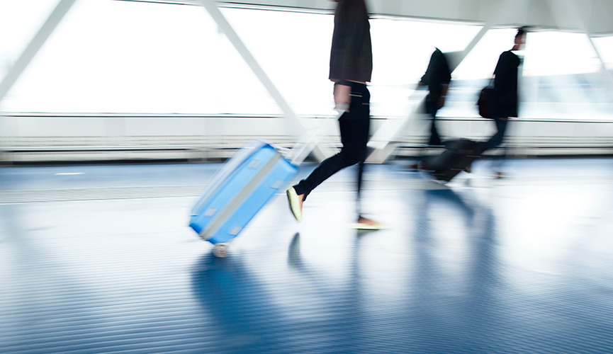 Person with luggage going through an airport