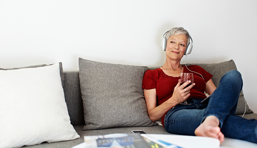 Woman happily listening to music with her headphones