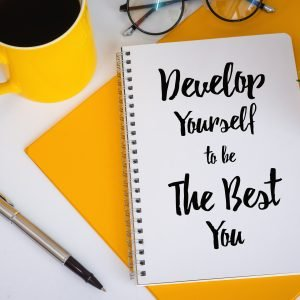 Notebook that says develop yourself to be the best you