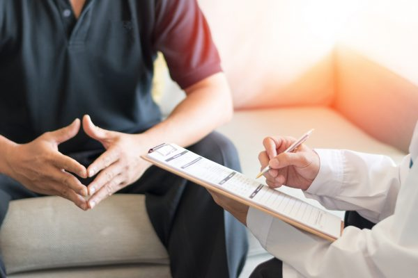 Physician consults with client
